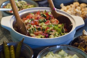 Bowl of classic Israeli salad.It is a chopped salad of finely diced tomato and cucumber.It's the most well-known national dish of Israel.
